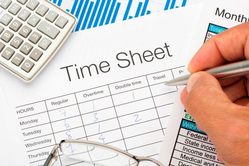 A man fillup timesheet form manually